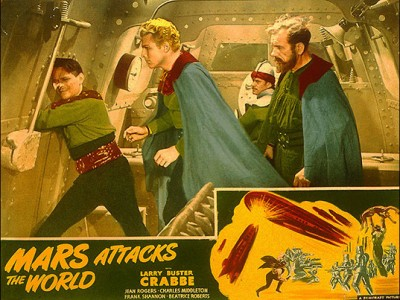 © Universal Pictures Mars attacks Earth - Flash Gordon and his scientist friend Doctor Zarkov prepare to impersonate the caped soldiers of Ming the Merciless, ruler of Mars.