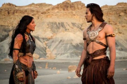 Lynn Collins and Taylor Kitsch as Dejah Thoris and John Carter