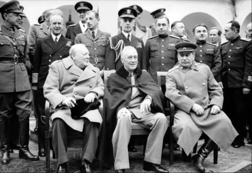 'The Big Three': Winston Churchill, Franklin D Roosevelt and Joseph Stalin sit for photographs during the Yalta Conference in February 1945. NAM 236 Part of WAR OFFICE SECOND WORLD WAR OFFICIAL COLLECTION
