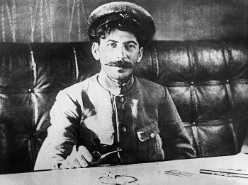The young Stalin Credit: Photo by Sovfoto/Universal Images Group/REX (3827290a)  Joseph stalin sitting at a table in 1918.  VARIOUS