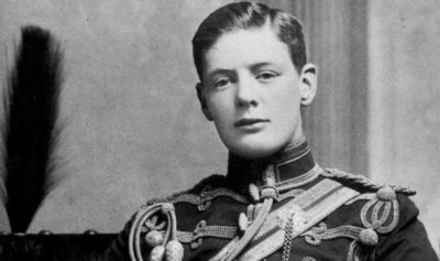 Churchill in the uniform of the Fourth Queen's Own Hussars. Do you think that's a disgruntled cat in the background?