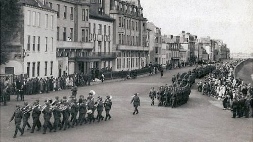 German troops marching along Guernsey's seafront during the occupation in WW2