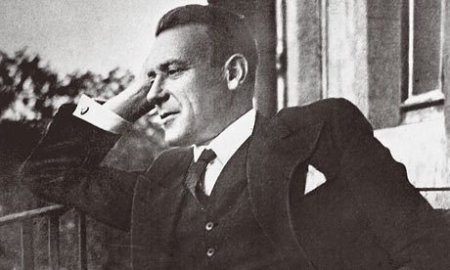 Mikhail Bulgakov at his Moscow flat, 1935. Photograph: © Collection Roger-Viollet